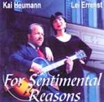 Kai Heumann in suit with jazz guitar and the Chinese singer Lei Errenst